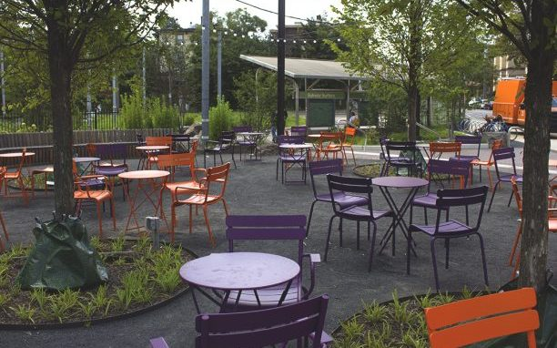 inviting outdoors space with chairs and tables near 40th Street and Baltimore Avenue
