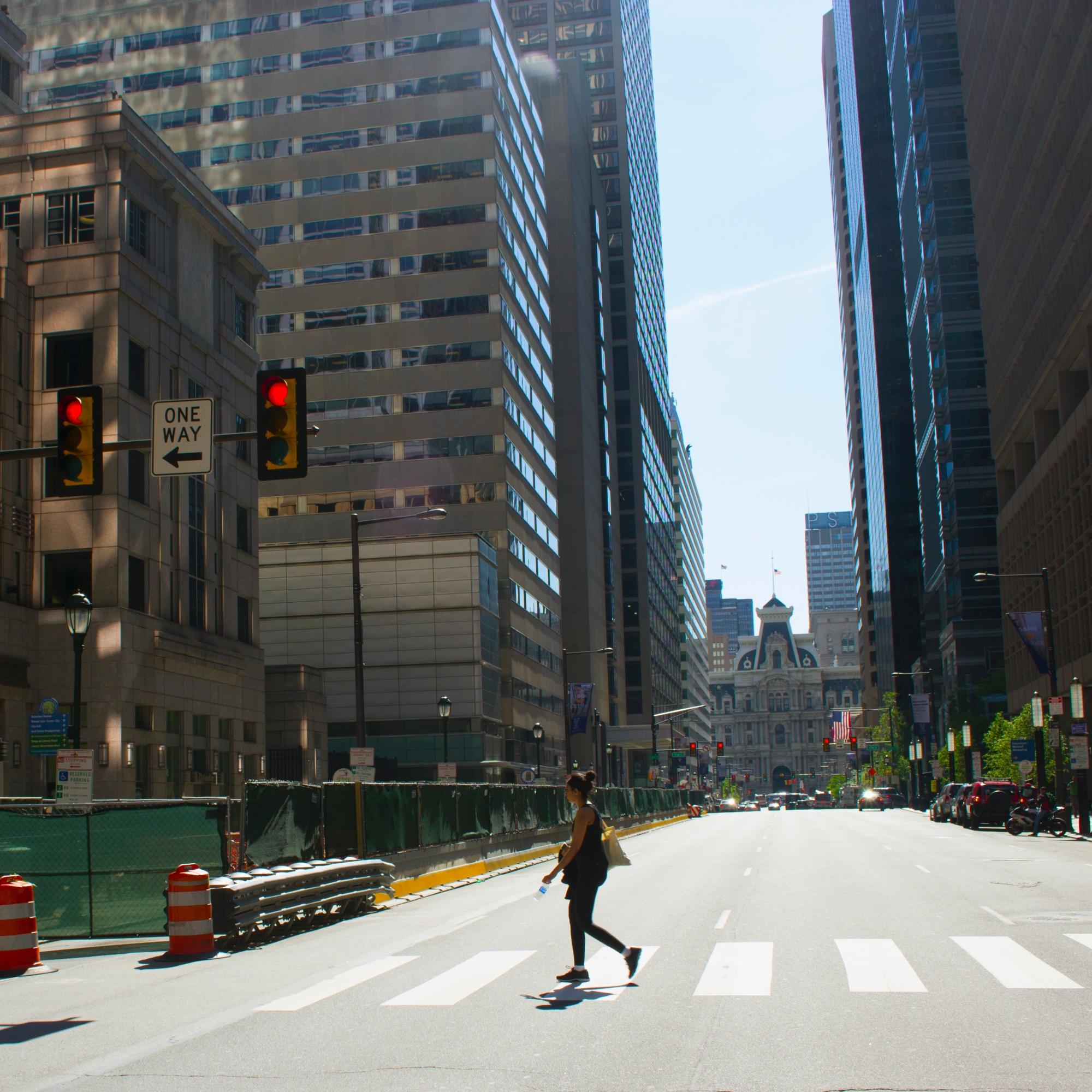 Woman crossing West Market Street in Center CIty Philadelphia